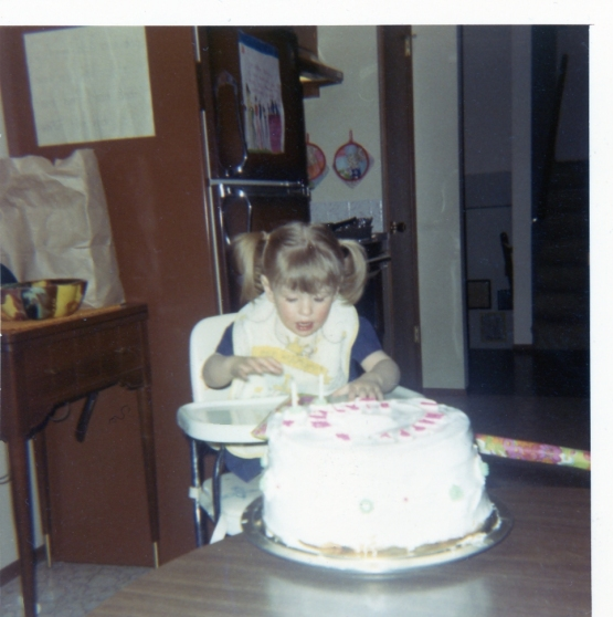 2nd birthday, ripping open a present in typical toddler fashion.