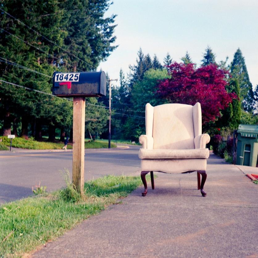 random chair on a sidewalk