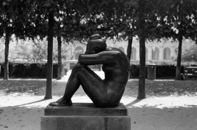 Lonely statue in a garden at the Louvre