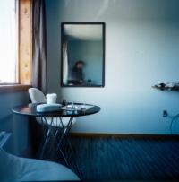 Self portrait in a hotel room mirror